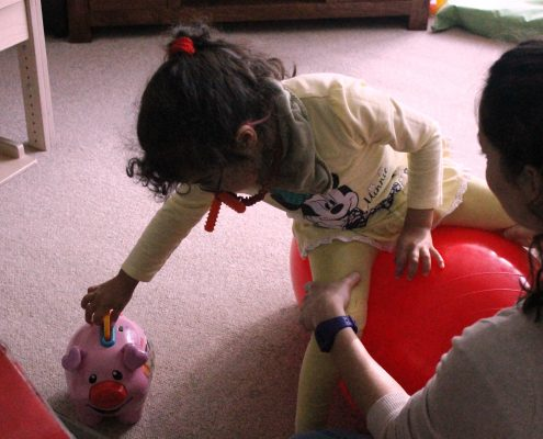 Child playing during physiotherapy session